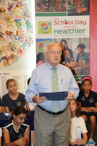 US Kevin Concannon presents a certificate of appreciation to Miami-Dade County School Superintendent Alberto Carvalho at North Beach Elementary School, Miami, FL, on August 23, 2012. (USDA photo by Debbie Smoot).