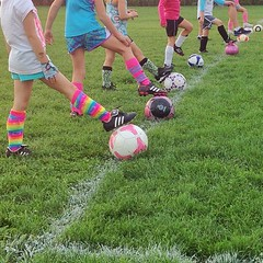 First grade girls playing #soccer = colorful socks