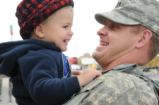 Homecoming Capt. Brad Loween, of the North Dakota Army National Guard's 1st Battalion, 112th Aviation Regiment (Security and Support), hugs his son Sept. 13, 2012 upon his return to Fargo, N.D., after a year-long deployment to Kosovo. Fifty-five North Dakota Guard Soldiers served with Kosovo Force 15 (KFOR 15) in support of NATO peacekeeping operations.