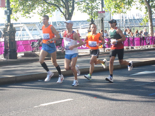 Blind runners with guides during the Paralympics 2012 marathon