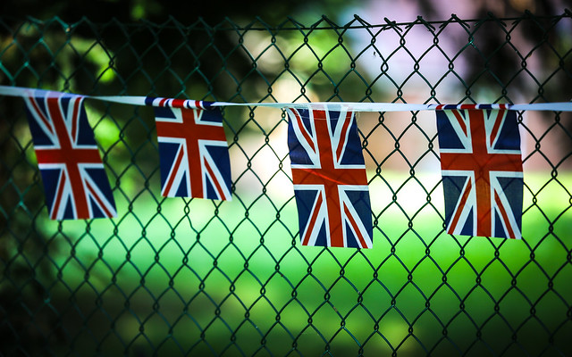 Union Jacks On A Fence