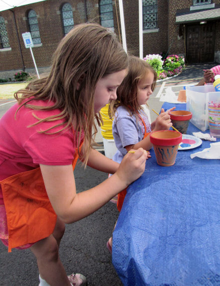 Girls Painting Pots at Farmers Market