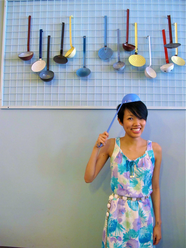 That's her scoop! Melissa models a ladle, and a 1960s floral sheath dress cinched with a white 1960s ah-go-go belt.