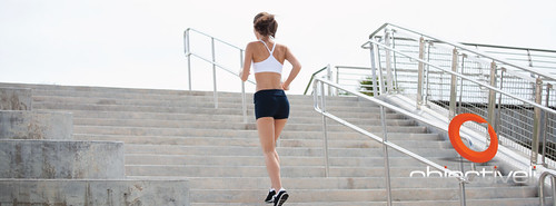 Woman Jogging up the stairs managing goals and objectives