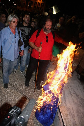Greek protesters burn EU flag at anti - austerity protest by Teacher Dude's BBQ