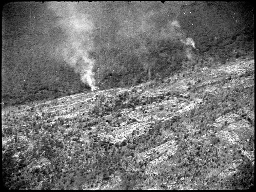 Aerial view of a smoke fire coming from rocks which was investigated during search for the 'Southern Cross', Kimberley region, Western Australia, 12 April 1929.