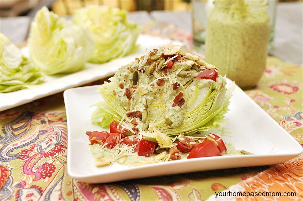 wedge of Mexican Caesar Salad topped with tomato and bacon