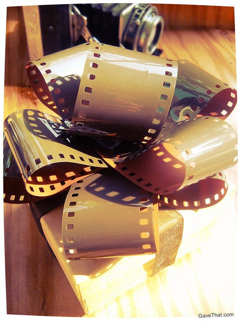 Finished DIY Camera Film Gift Bows on a present by gift wrap blog Gave That