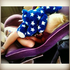 Elliora napping all snuggled up with her Star Bear.