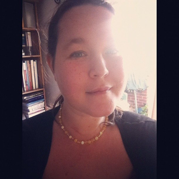 "Ola. Sporting my new amber ""teething"" necklace. Ha ha. Bought an amber necklace for Elliot and Dylan. Had to have one for myself too! ;)"