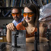 Maggie Molter '14 and Professor James Heyman adjust optical components in Professor Heyman's lab.