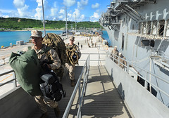 Marines assigned to the 31st Marine Expeditionary Unit (31st MEU), come aboard the forward-deployed amphibious assault ship USS Bonhomme Richard (LHD 6) during an embarkation in Okinawa, Aug. 20. (U.S. Navy photo by Mass Communication Specialist 2nd Class Michael Russell)