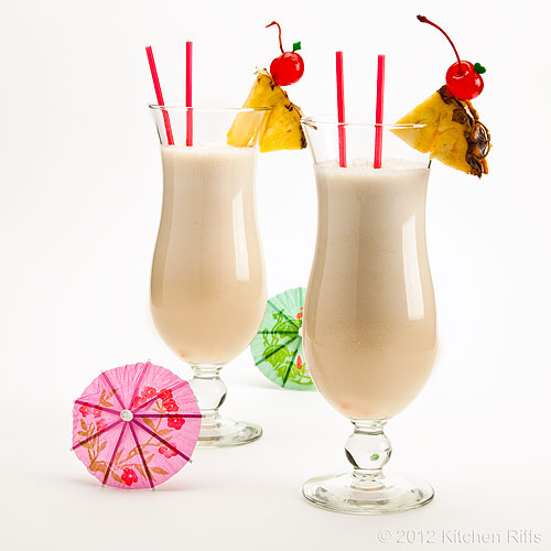 Piña Colada Cocktails with Pineapple and Maraschino Cherry Garnish, White Background