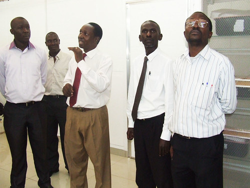 The laboratory technician (in red tie) taking the guests through the facility