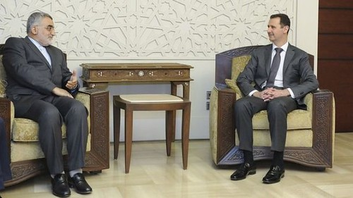 Syria President Assad with Iran Majlis foreign policy committee member Alaeddin Boroujerdi. Syria has been fighting US-backed rebels for over a year. by Pan-African News Wire File Photos
