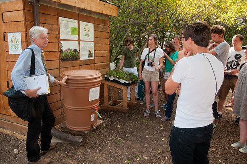 USDA National Landscape Architect, Natural Resources Conservation Service Bob Snieckus (left), demonstrates the construction and operation of a rain barrel attached to a sustainably built shed that has a green roof to French students from Ecole Du Breuil, School of Horticulture and Landscaping , Paris, France.