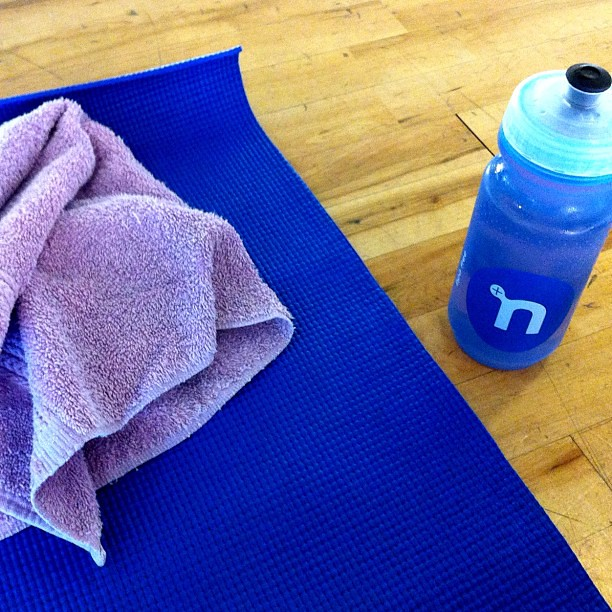 Yoga and a little @nuunhydration this morning. Hopefully I can stretch out my aches and pains this morning before my long run tomorrow.
