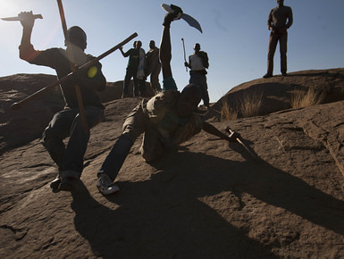 South African miners at Lonmin where 34 people were killed on August 16, 2012. The government of Jacob Zuma has pledged to establish a commission of inquiry. by Pan-African News Wire File Photos