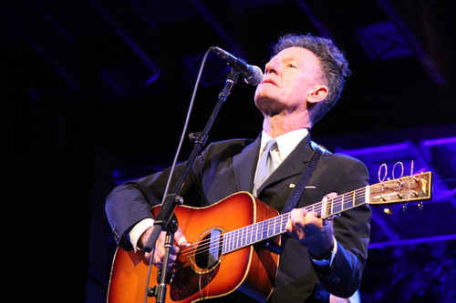 Lyle Lovett playing