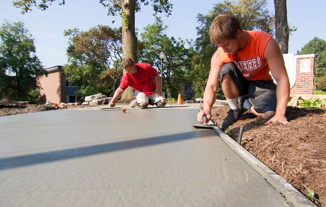 Sidewalk finishing at Cherry and Berrien on the Knox campus. Photo by John Williams