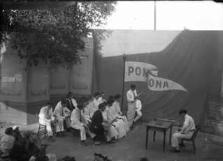 1904 Wash Day program put on by seniors - students act out a classroom scene on a makeshift outdoor stage
