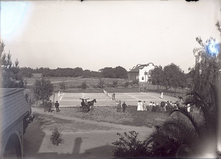Tennis match at Pomona College (1904). Renwick Gymnasium is in the background.