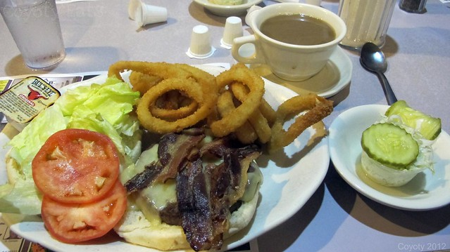 Deluxe bacon Swiss burger with onion rings