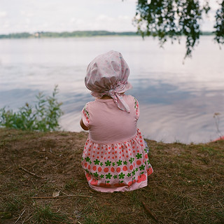 Vasilisa observes the Volga river as she is sitting on her pot