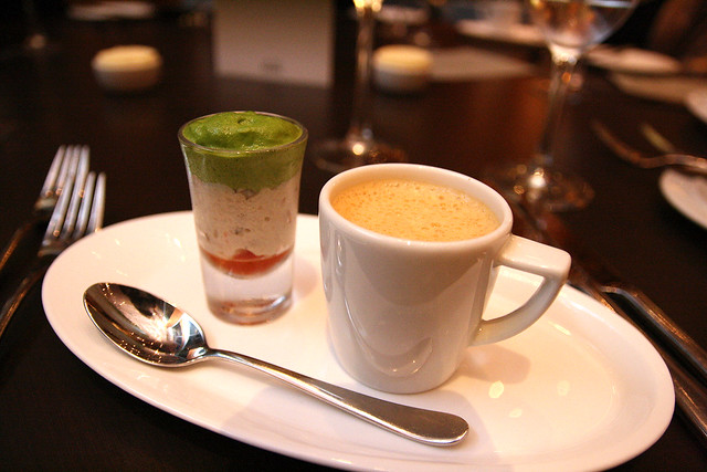 Amuse bouche of lobster bisque with fennel, crab salad