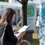 Reading brochure in the sunshine | Reading a Book Festival brochure in the sunshine