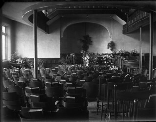 The Holmes Hall chapel decorated with flowers for the funeral of Pomona College student Vernon Wolcott, who died of pneumonia on March 15, 1904.