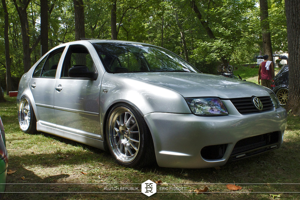 reflex silver mk4 jetta 2.0 1.8t vr6 klutch sl14 wheels votex bumper 3pc wheels static airride low slammed coilovers stance stanced hellaflush poke tuck negative postive camber fitment fitted tire stretch laid out hard parked seen on klutch republik at midwest volksfest 2012