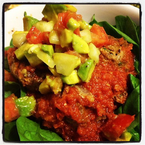 Whole30 day 17. Dinner. Green chile taco meatballs with chipotle tomato sauce and avocado salsa over greens. Mmmm.