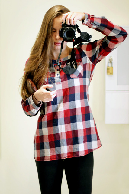 Wearing a plaid shirt from House and black leggings from Calliope