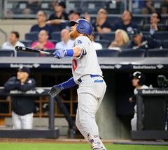 The Dodgers' Justin Turner flies out in the first inning.