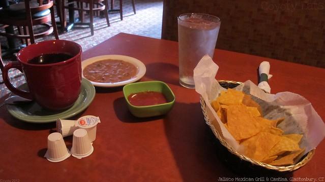 Tortilla chips, bean dip, salsa, and coffee