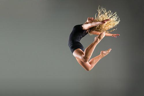 portrait female hair studio movement creative dancer blond leap