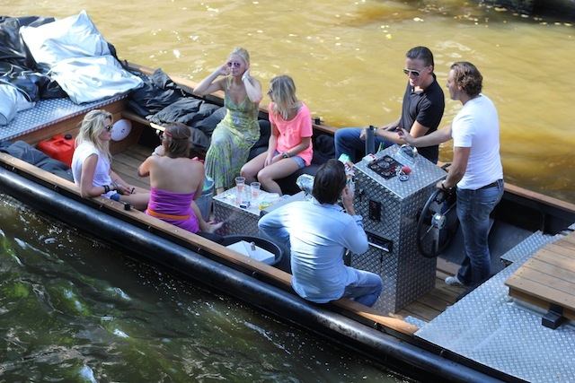 Friends boating in Amsterdam