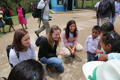 Claire Diaz-Ortiz, America Ferrera, and Alexis Bledel talk to a group of children in Honduras