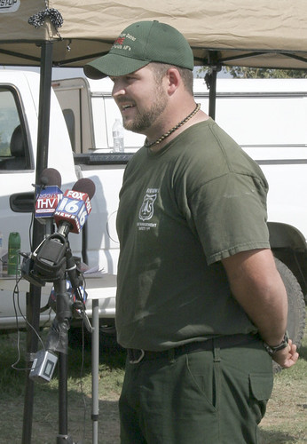 Forest Service employee Bradley Taylor, an emergency medical technician and search and rescue technician on the Ozark-St. Francis National Forest, speaks to reporters Wednesday, Sept. 12, in Stone County, Ark., after finding Landen Trammell playing in a puddle about 30 hours after the toddler disappeared. Photo credit: Courtesy of Lori Freeze, Stone County Leader