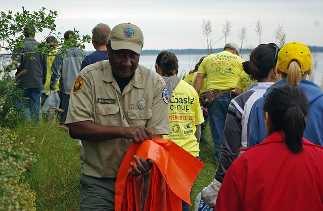 Maurice Suggs, Park Ranger at York River State Park, hands out bags for volunteers to collect trash along the river at last year's National Public Lands Day event.