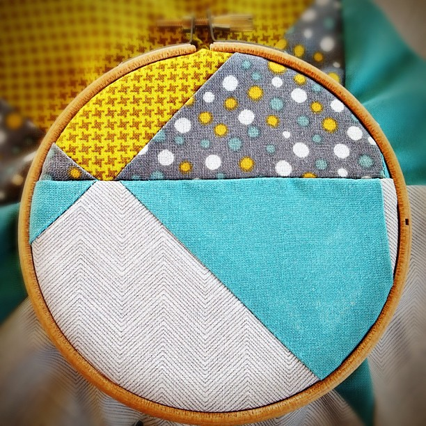 Tonight's football practice craft: embroidering a little somethin' on my first-ever quilt block. #quilting #embroidery I like how the piecing ends up looking in the small hoop!