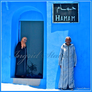 387. Woman and the Blind Man in front of the Hammam, Chaouen, Morocco