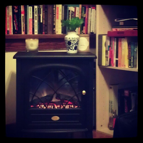 The fake fireplace is roaring. (With help from a hearth-scented candle.)