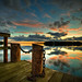 Sunsets by an old dock by Appe Plan