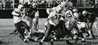 Gary Martinson '55 carries the ball in this photo from the Sagehens' undefeated 1954 season.