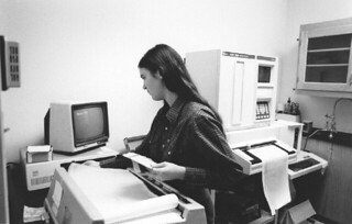 Student working with a Cary 2300 UV/VIS/NIR spectrophotometer in Seaver North in 1985
