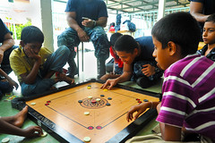 Aviation Machinist's Mate 3rd Class Harley Aldave plays a board game wtih children from Agathian's Shelter for Boys during a community service event Oct. 10 as part of USS George Washington's (CVN 73) port visit to Port Klang, Malaysia. Sailors took part in numerous community service activities throughout the course of the port vistit. (U.S. Navy photo by Mass Communication Specialist Seaman Tatiana Avery)