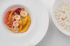 Grilled sea water prawns with mango and curry. In…