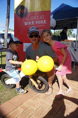 Will, on his wooden bike, with his dad and sister at the Carnarvon Growers Markets